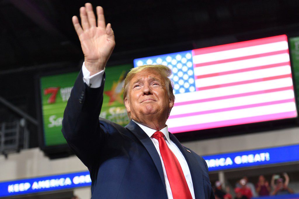 President Donald Trump waves to supporters as he arrives for a campaign rally in Rio Rancho, N.M.
