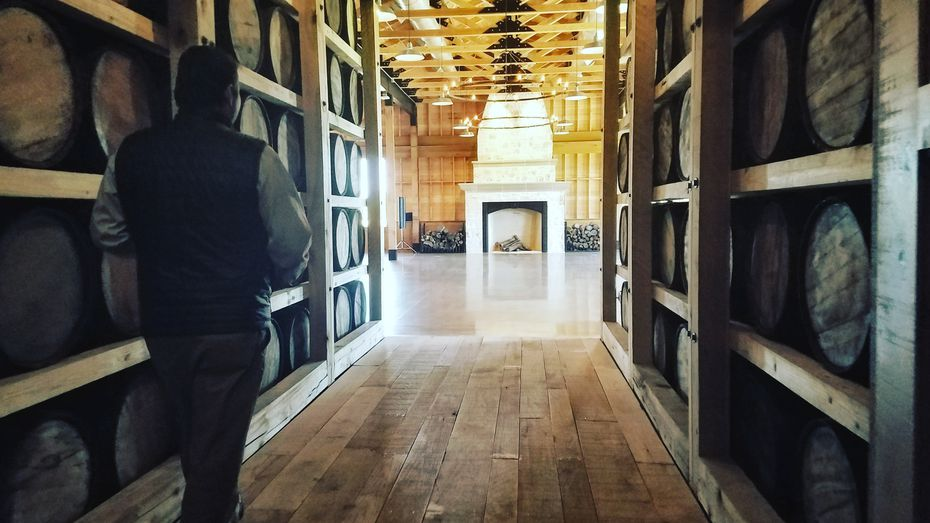 """Co-founder Robertson courses the """"barrel breezeway"""" path leading to the Oak Room, a chandelier-adorned special-events space for up to 180 people."""