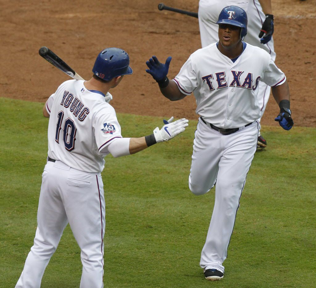 Texas Rangers third baseman Adrian Beltre (29) is congratulated by  Michael Young (10) after Beltre hit a solo home run off of Seattle Mariners pitcher Blake Beaven in the 4th inning, during the MLB baseball game on Sunday, September 16, 2012.   (Michael Ainsworth/Staff Photographer)