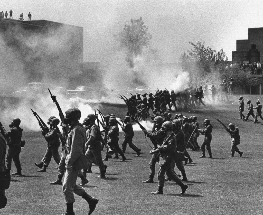 In a May 4, 1970 file photo, Ohio National Guard moves in on rioting students at Kent State University in Kent, Ohio. Four persons were killed and several wounded when National Guardsmen opened fire.