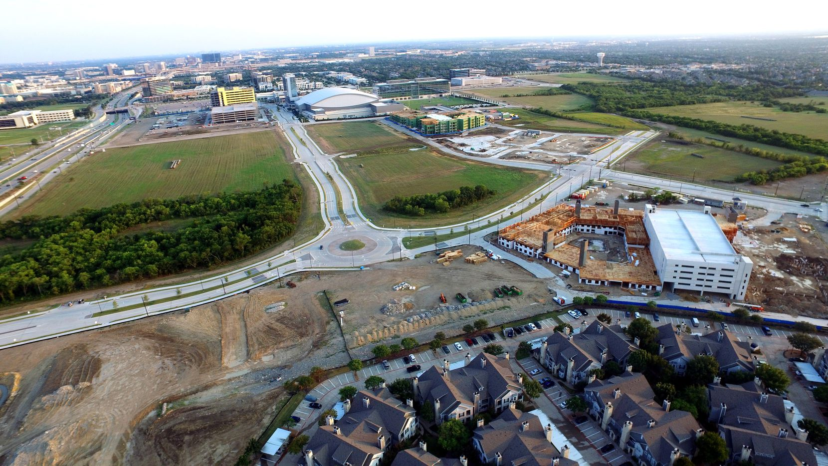 Embrey Partners' apartment development is under construction (upper right) in The Gate development in Frisco.