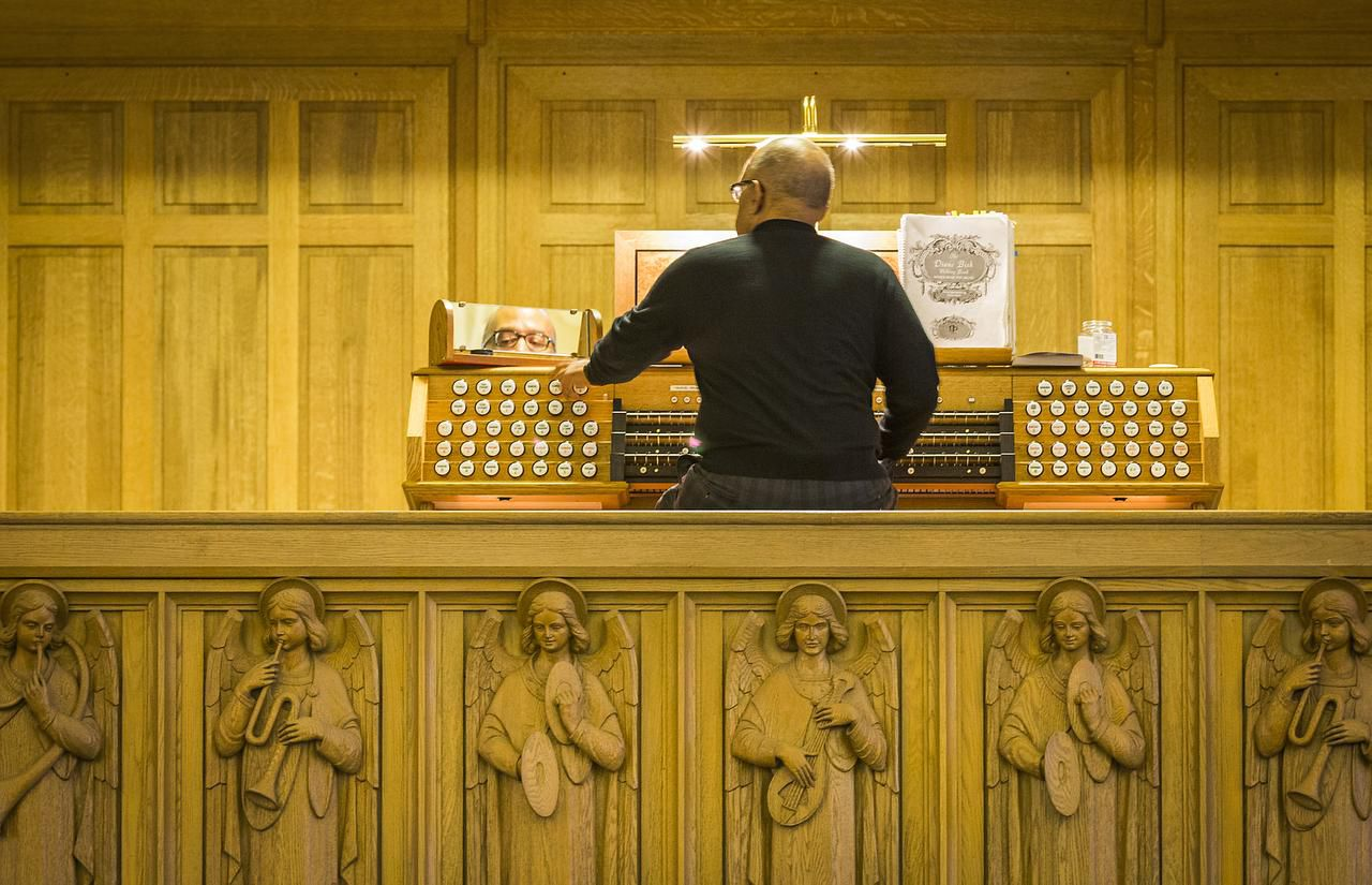 Organist Henry McDowell plays the organ at Christ the King Catholic Church.