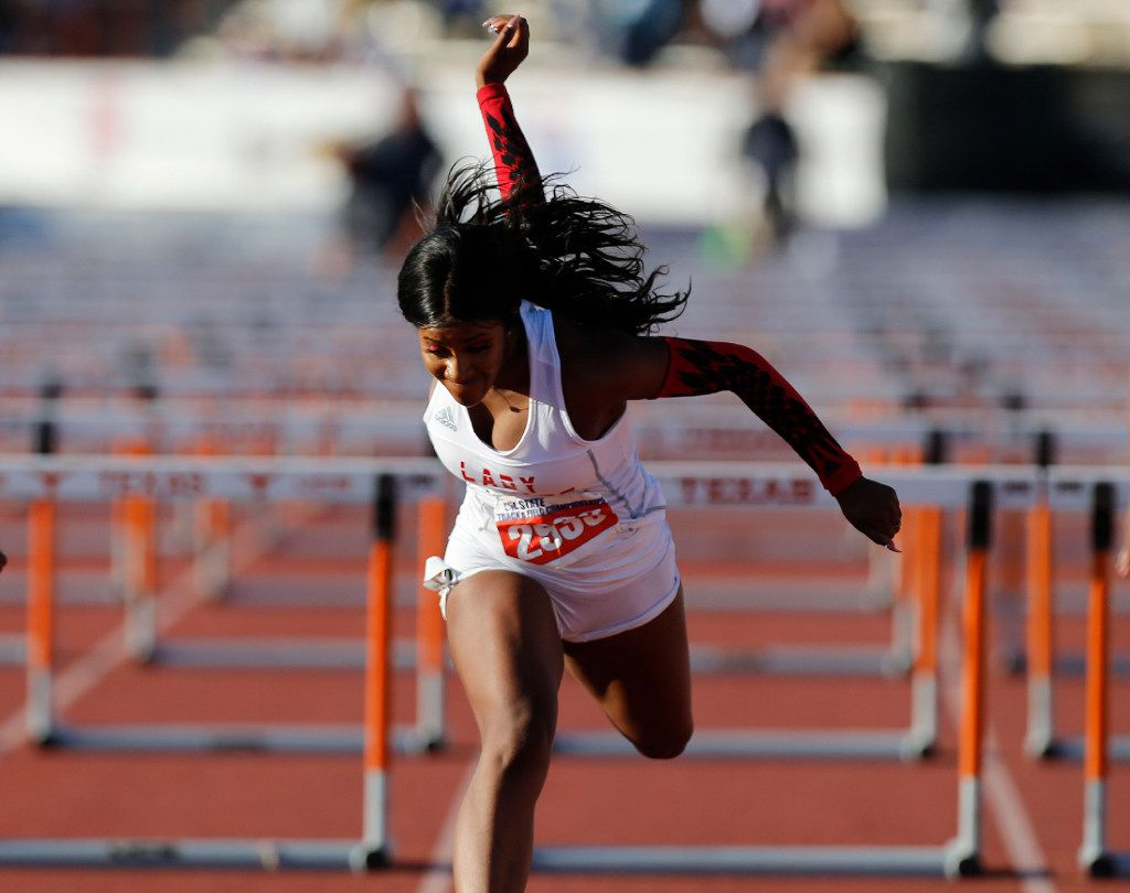 Mesquite Horn's Kaylor Harris (2933) finishes first in the class 6A girls 100-meter hurdles during the UIL state track and field meet in Austin, Saturday, May 13, 2017. (Stephen Spillman/Special Contributor)