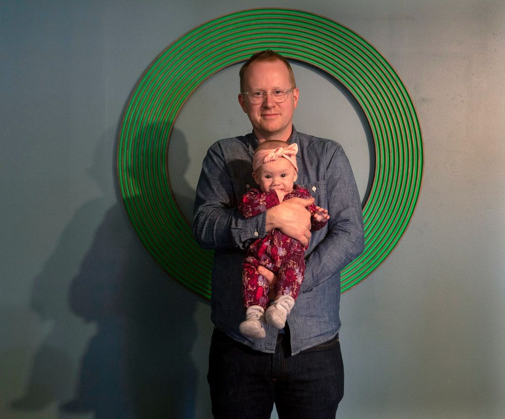 Artist Ryan Goolsby and his daughter Frances Fern photographed with Untitled, 2018-19, Bronze with Patina, Wooden Armature, 48 x 48 x 2  at Ryan Goolsby at Randy Guthmiller Center for the Advancement of the Arts in Dallas.
