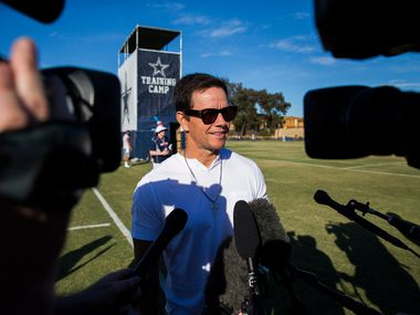 Actor and business man Mark Wahlberg speaks to reporters during an afternoon practice at training camp in Oxnard, California on Saturday, August 3, 2019. (Ashley Landis/The Dallas Morning News)