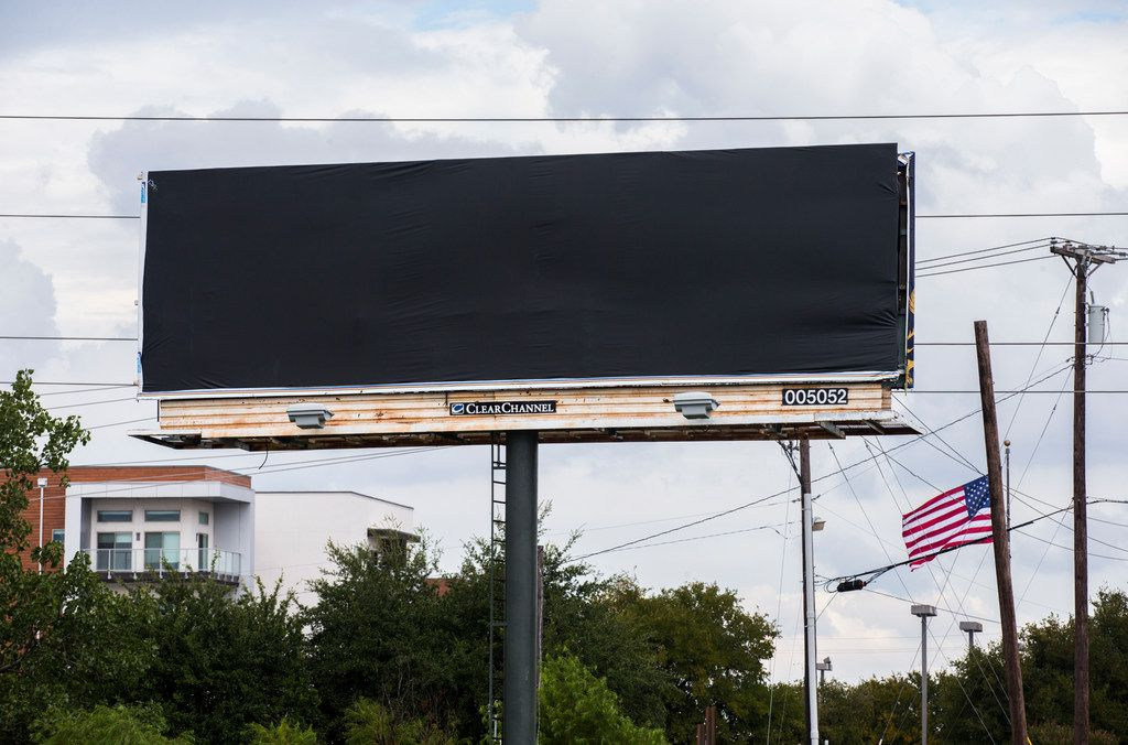 A covered billboard  near Baylor Scott & White Medical Center - Plano, on Friday.