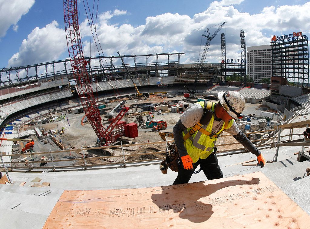 A worker measures a piece of wood as work continues on SunTrust Park, the future home of the Atlanta Braves. The stadium, in unincorporated Cobb County, Ga., will open in time for the 2017 baseball season.