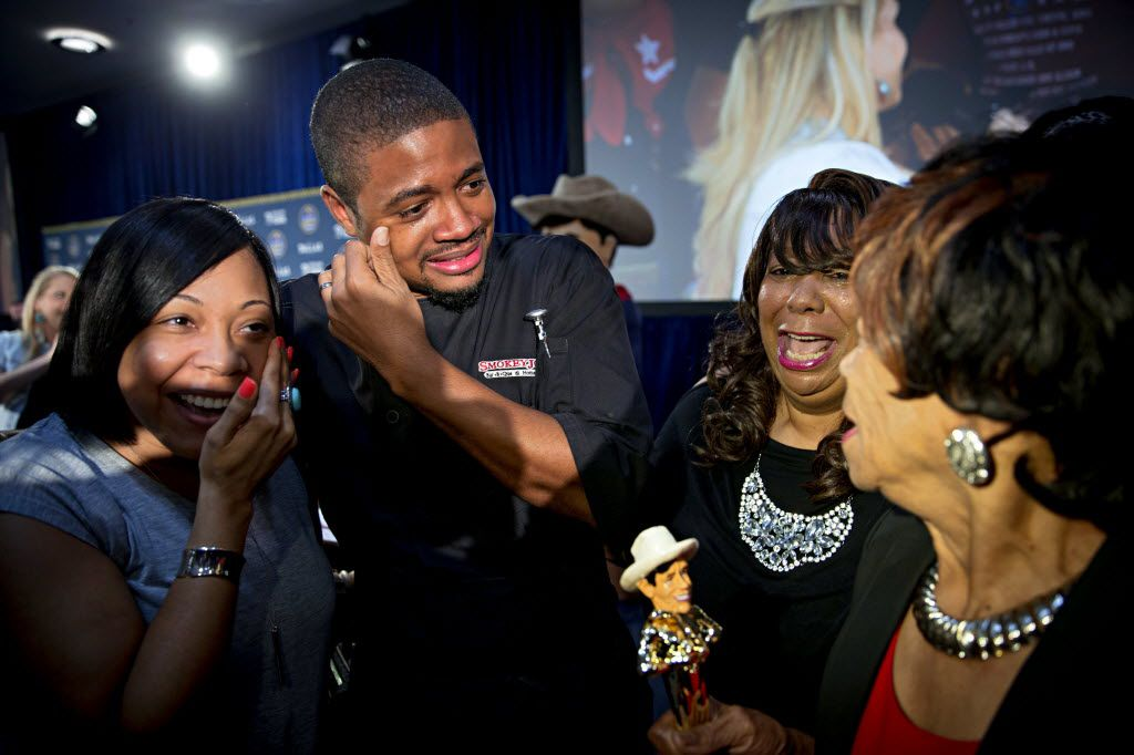"""Brent Reaves (second from left) and family react after he and his team won """"Best Taste"""" for the Fried Jell-O during the 2016 Big Tex Choice Awards Sunday, August 28, 2016 at Fair Park in Dallas. The annual event, held ahead of the State Fair of Texas, recognizes the best fried foods entered into consideration for sale at the fair. (G.J. McCarthy/The Dallas Morning News)"""