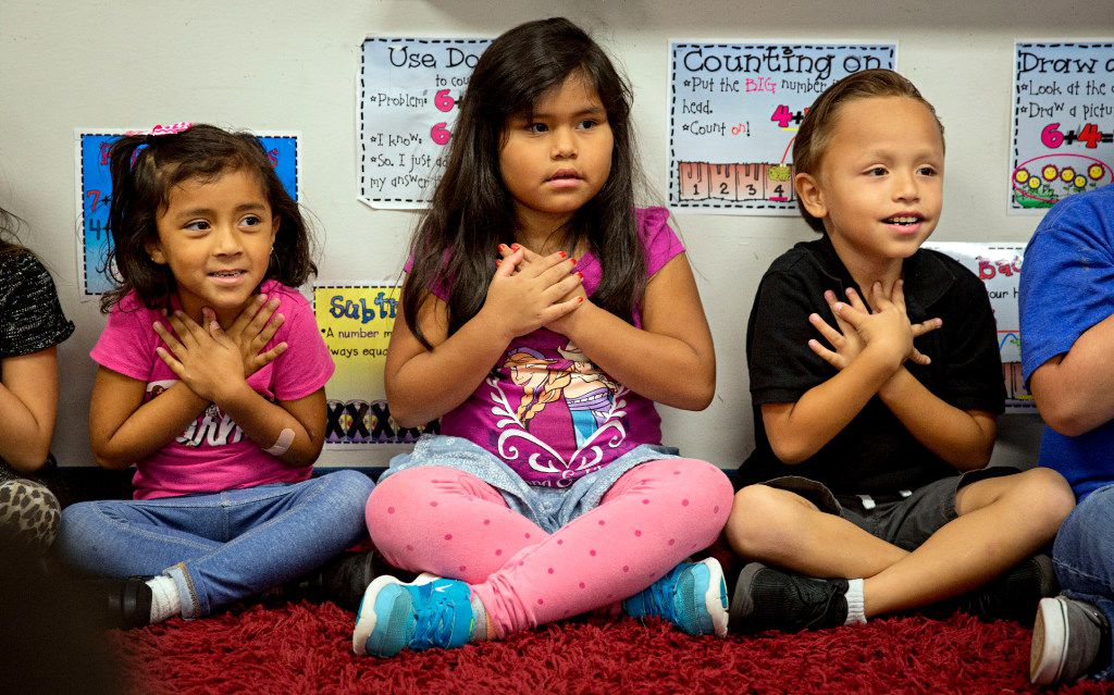(From left) Kathya Rios, Giselle Reyes and Pablo Molina take part in a mindfulness exercise during class at Davis Elementary Monday, September 19, 2016 in Carrollton, Texas.
