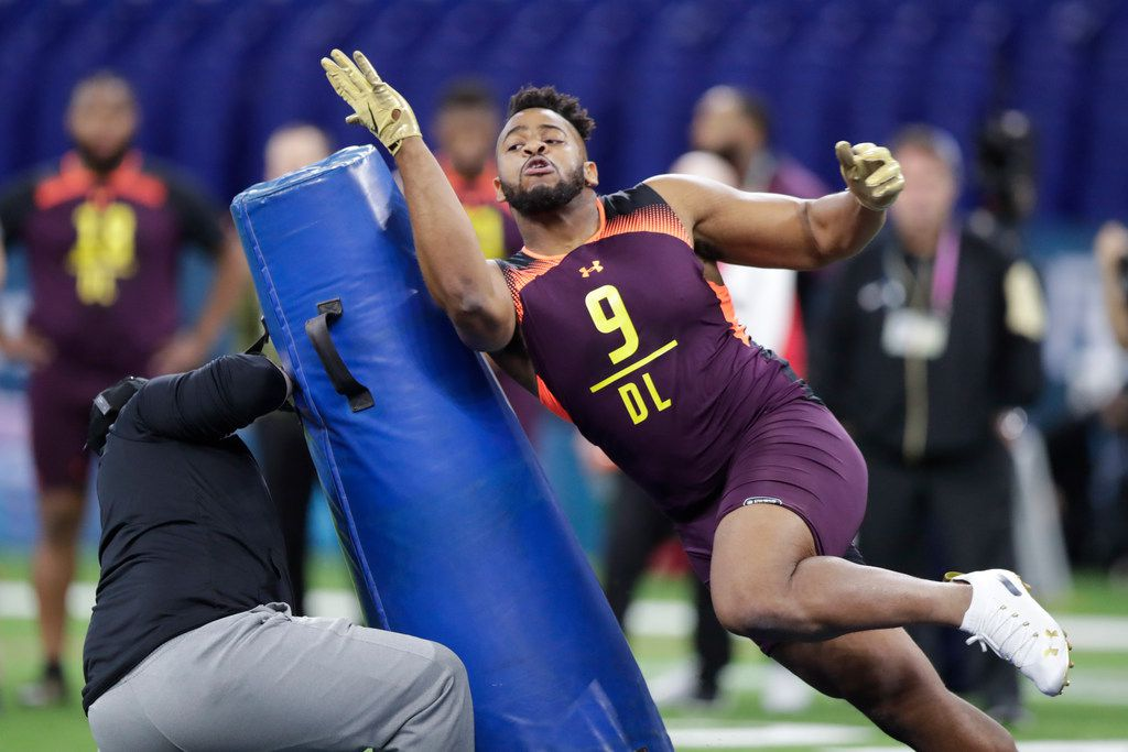 Texas A&M defensive lineman Kingsley Keke runs a drill at the NFL football scouting combine in Indianapolis, Sunday, March 3, 2019. (AP Photo/Michael Conroy)