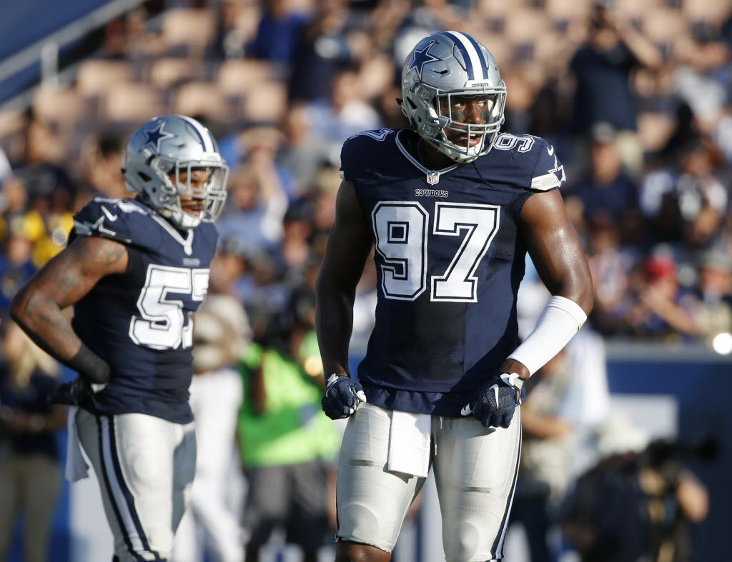 Dallas Cowboys defensive end Taco Charlton (97) makes his way to the line after breaking from a huddle during the first half of play in a preseason game between the Dallas Cowboys and Los Angeles Rams at Los Angeles Memorial Coliseum in Los Angeles, California on Saturday, August 12, 2017. (Vernon Bryant/The Dallas Morning News)