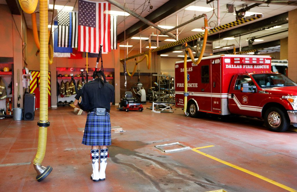 Jim Royer of the Dallas Fire Fighters Pipes & Drums plays the bagpipes during a September 11 remembrance ceremony at Dallas Fire Station 18 in Dallas on Tuesday on September 11, 2018. (Vernon Bryant/The Dallas Morning News)