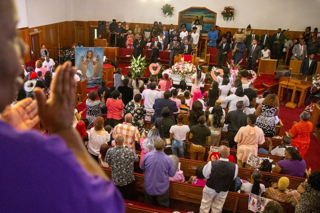 Mourners gather during the funeral for 9-year-old Brandoniya Bennett at the New Morning Star Missionary Baptist Church on Friday. Bennett was shot and killed inside her Old East Dallas apartment last week.