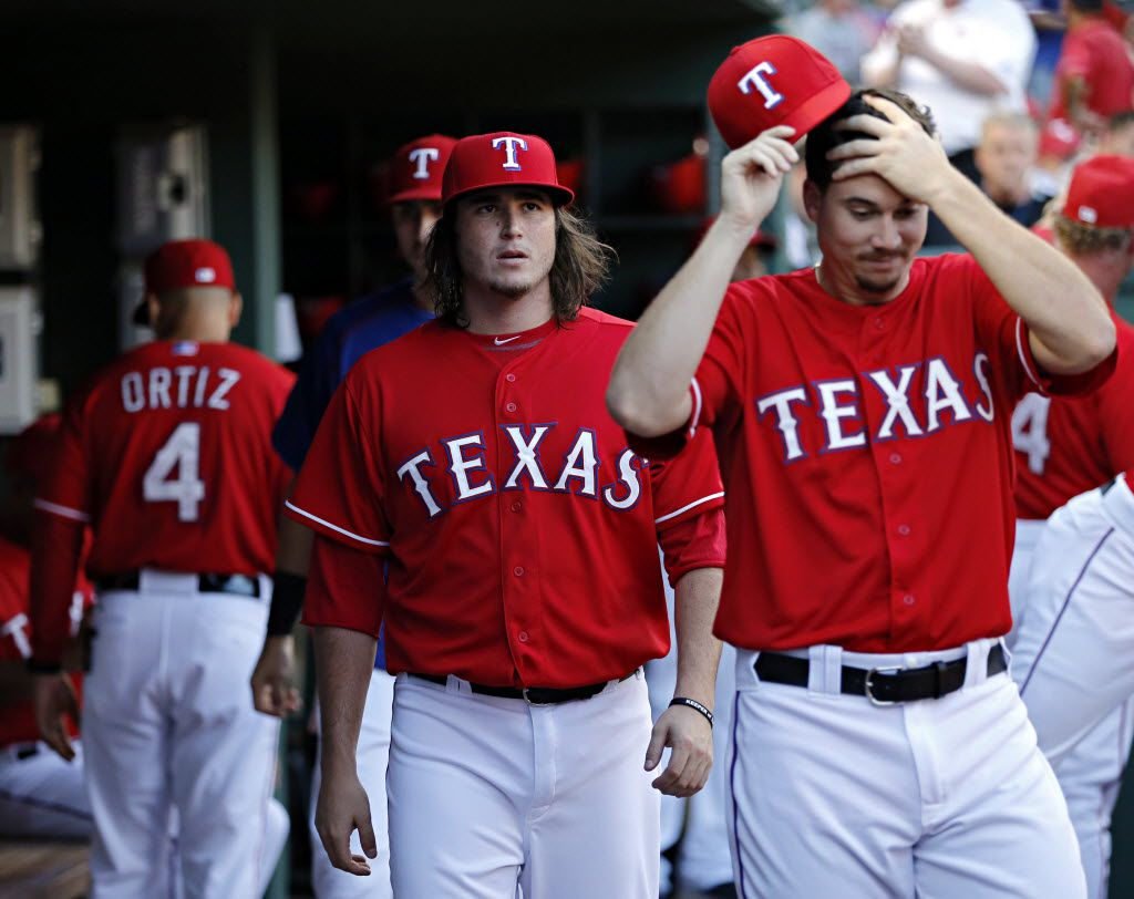 Texas Rangers relief pitchers Luke Jackson (center) and Chi Chi Gonzalez roam the dugout during Texas' 10-1 win over the Seattle Mariners Saturday, September 19, 2015 at Globe Life Ballpark in Arlington, Texas. (G.J. McCarthy/The Dallas Morning News)