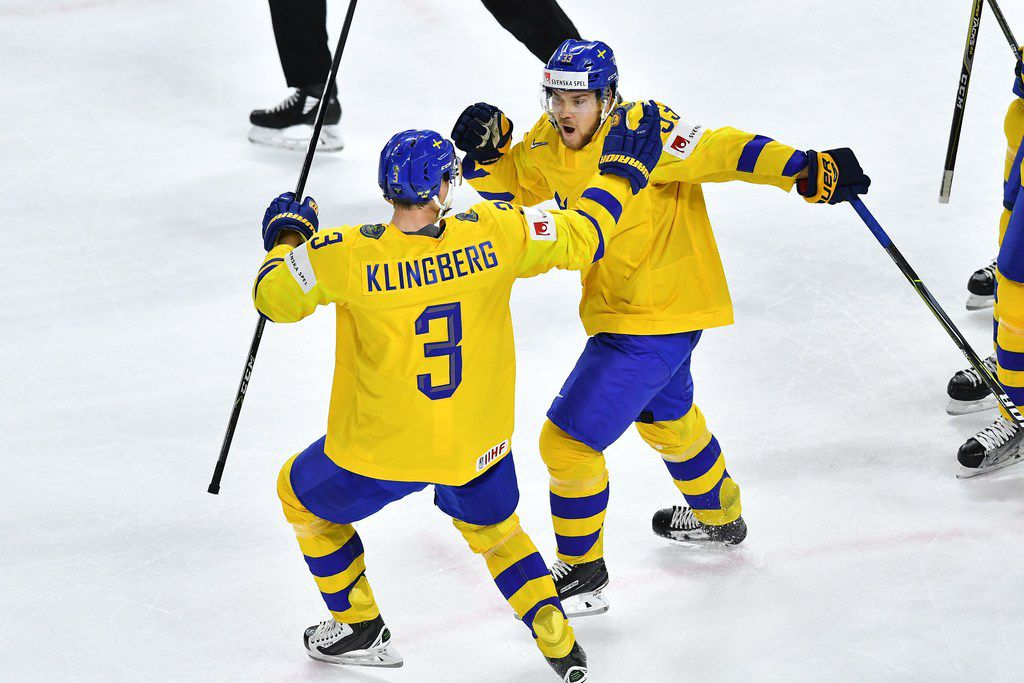 Sweden's Viktor Arvidsson (R) celebrates with teammate Sweden's John Klingberg after scoring during the semifinal match Sweden vs USA of the 2018 IIHF Ice Hockey World Championship at the Royal Arena in Copenhagen, Denmark, on May 19, 2018. / AFP PHOTO / JOE KLAMARJOE KLAMAR/AFP/Getty Images