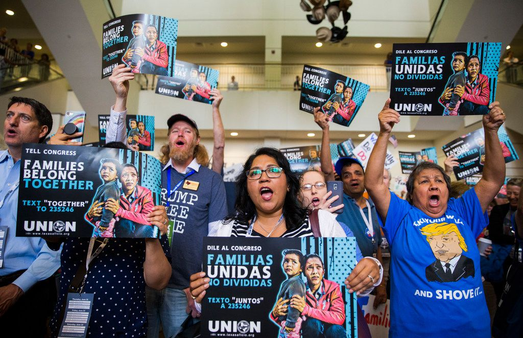 People chant and hold signs during a Families First Rally at the Texas Democratic Convention on Saturday, June 23, 2018 at the Fort Worth Convention Center in Fort Worth.