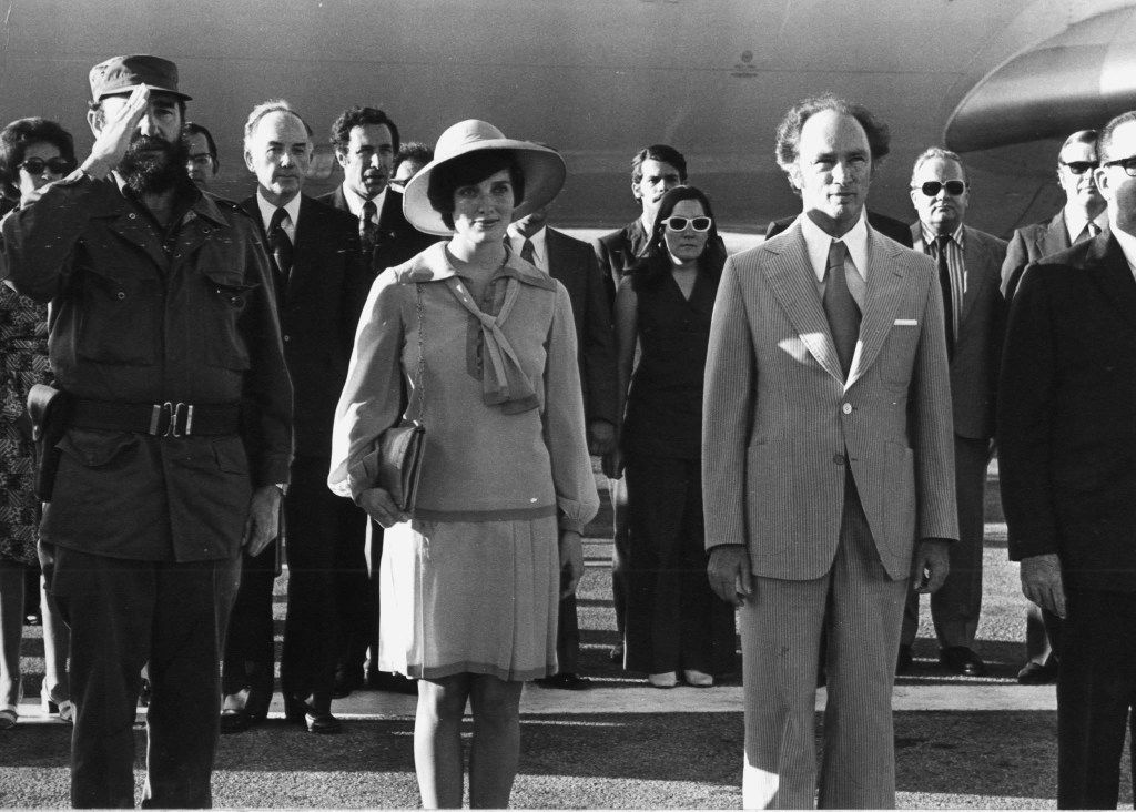 In this Jan. 26, 1976 photo, Prime Minister Pierre Trudeau and wife Margaret and Cuban President Fidel Castro listen to the national anthems of both countries after the Trudeaus arrived in Havana, Cuba.