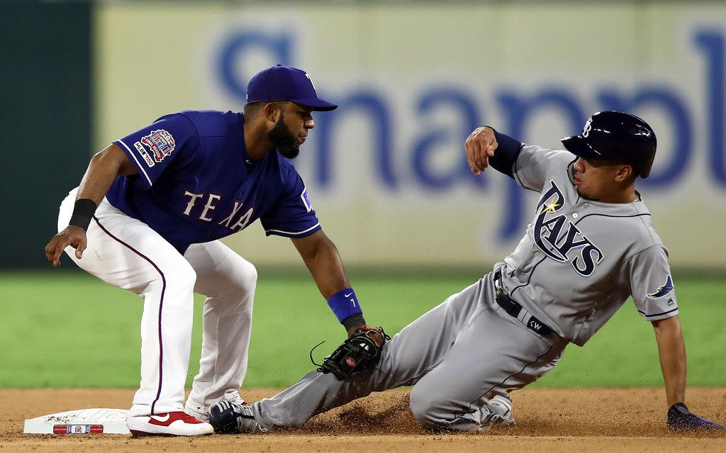 Texas Rangers infielder Elvis Andrus, left, applies the tag to catch the Tampa Bay Rays' Kean Wong stealing second base in the seventh inning at Globe Life Park in Arlington on Tuesday, Sept. 10, 2019, in Arlington, Texas. The Rays won, 5-3, in 11 innings. (Ronald Martinez/Getty Images/TNS) **FOR USE WITH THIS STORY ONLY**