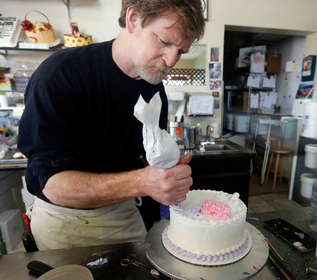 Masterpiece Cakeshop owner Jack Phillips decorates a cake inside his store in Lakewood, Colo., in 2014. The Supreme Court is setting aside a Colorado court ruling against a baker who wouldn't make a wedding cake for a same-sex couple. But the court is not deciding the big issue in the case, whether a business can refuse to serve gay and lesbian customers.