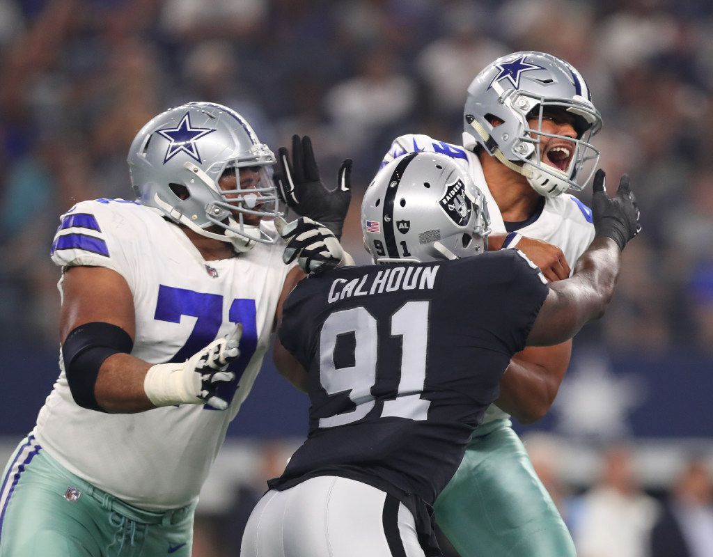 ARLINGTON, TX - AUGUST 26: La'el Collins #71 of the Dallas Cowboys tries to protect Dak Prescott #4 of the Dallas Cowboys as he is hit by Shilique Calhoun #91 of the Oakland Raiders in the second quarter of a preseason game at AT&T Stadium on August 26, 2017 in Arlington, Texas. (Photo by Tom Pennington/Getty Images)