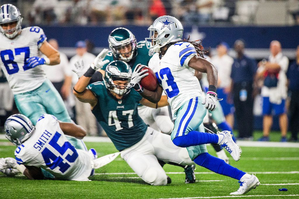 Dallas Cowboys wide receiver Lucky Whitehead (13) returns a kick that was brought back due to a penalty against running back Rod Smith (45) blocking Philadelphia Eagles tight end Trey Burton (47) during the first half of an NFL football game at AT&T Stadium on Sunday, Oct. 30, 2016, in Arlington. (Smiley N. Pool/The Dallas Morning News)