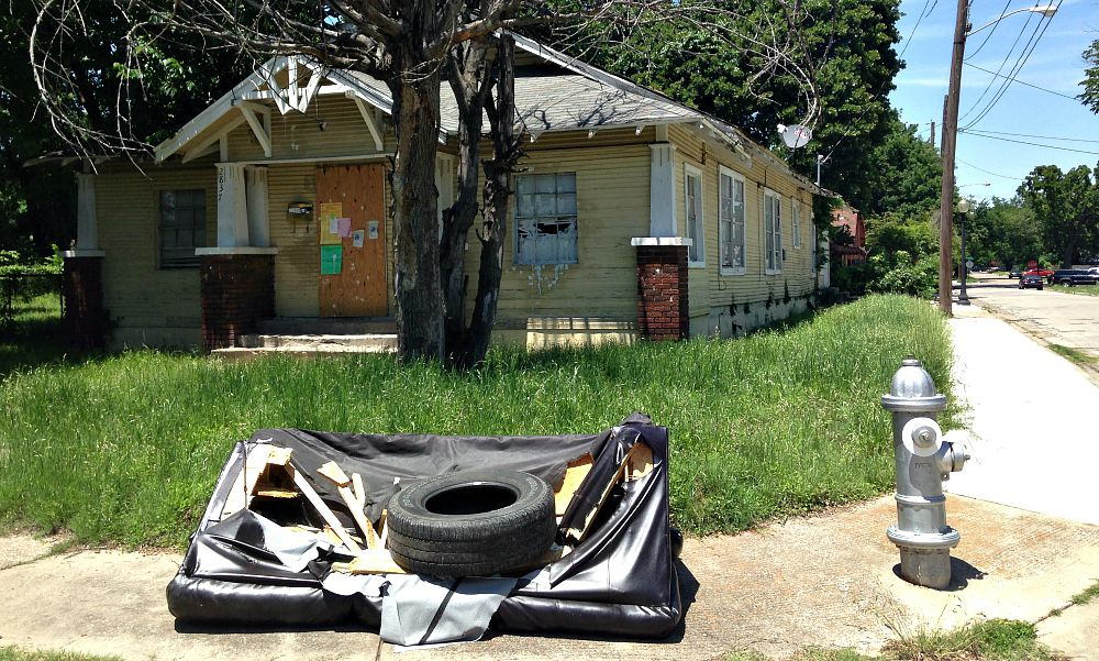 The house at 2839 Tanner Street in South Dallas has code violations nailed to it that date back months. They say the owner is a company on Lemmon Avenue.