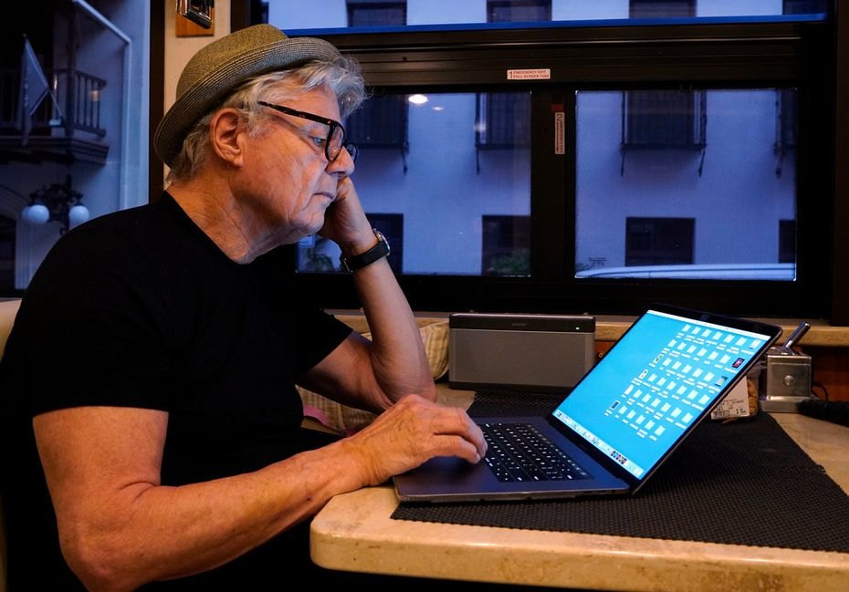 Steve Miller of the Steve Miller Band checks his emails on his tour bus before his concert at the Majestic Theatre in San Antonio,
