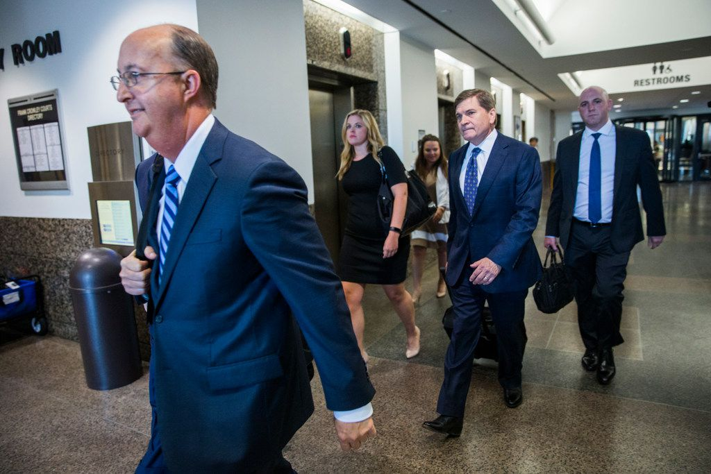 Defense attorneys Robert Rogers (left), Toby Shook (second from right) and Zach Horn (right) leave the Central Jury Room after potential jurors were questioned Friday at the Frank Crowley Courts Building in Dallas.