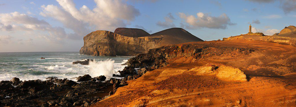 The Capelinhos volcano on the Azores island of Faial forced much of the region's population to emigrate when it erupted in the late 1950s. A black-sand wasteland — with an 1894 lighthouse partly buried in ash — now sits beside the shore as a reminder.