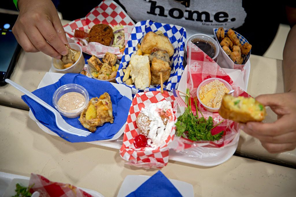 A fan consumes a tray full of entries during the 2016 Big Tex Choice Awards Sunday, August 28, 2016 at Fair Park in Dallas. The annual event, held ahead of the State Fair of Texas, recognizes the best fried foods entered into consideration for sale at the fair. (G.J. McCarthy/The Dallas Morning News)