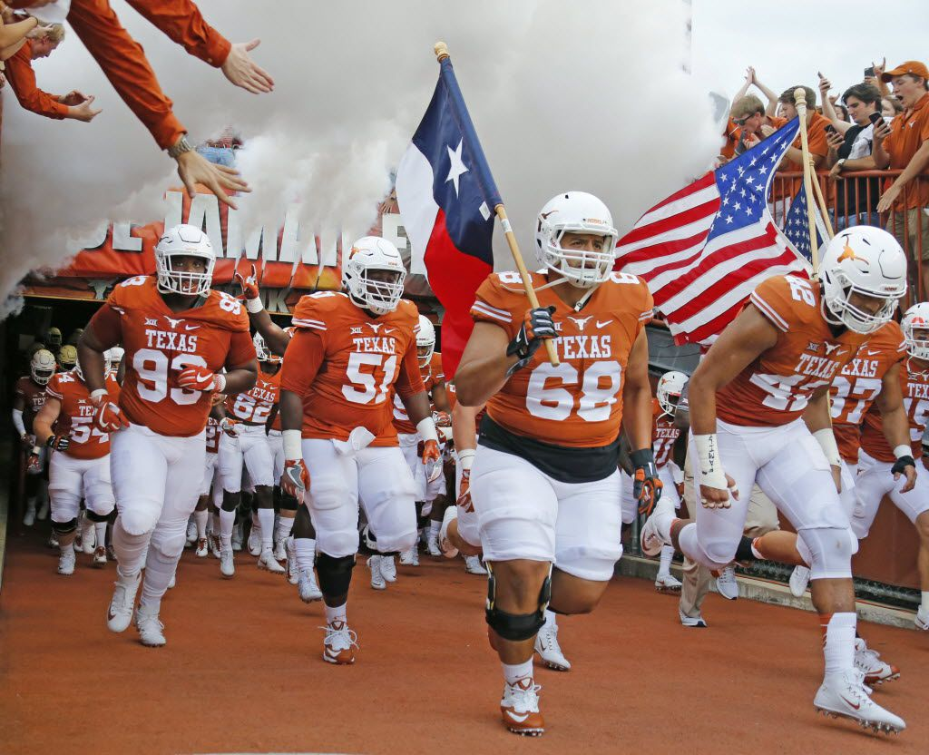 The Texas Longhorns take the field led by Texas offensive lineman Frank Lopez (68) before the Notre Dame Fighting Irish vs. the University of Texas Longhorns NCAA football game at Darrell K. Royal Memorial Stadium in Austin on Sunday, September 4, 2016. (Louis DeLuca/The Dallas Morning News)