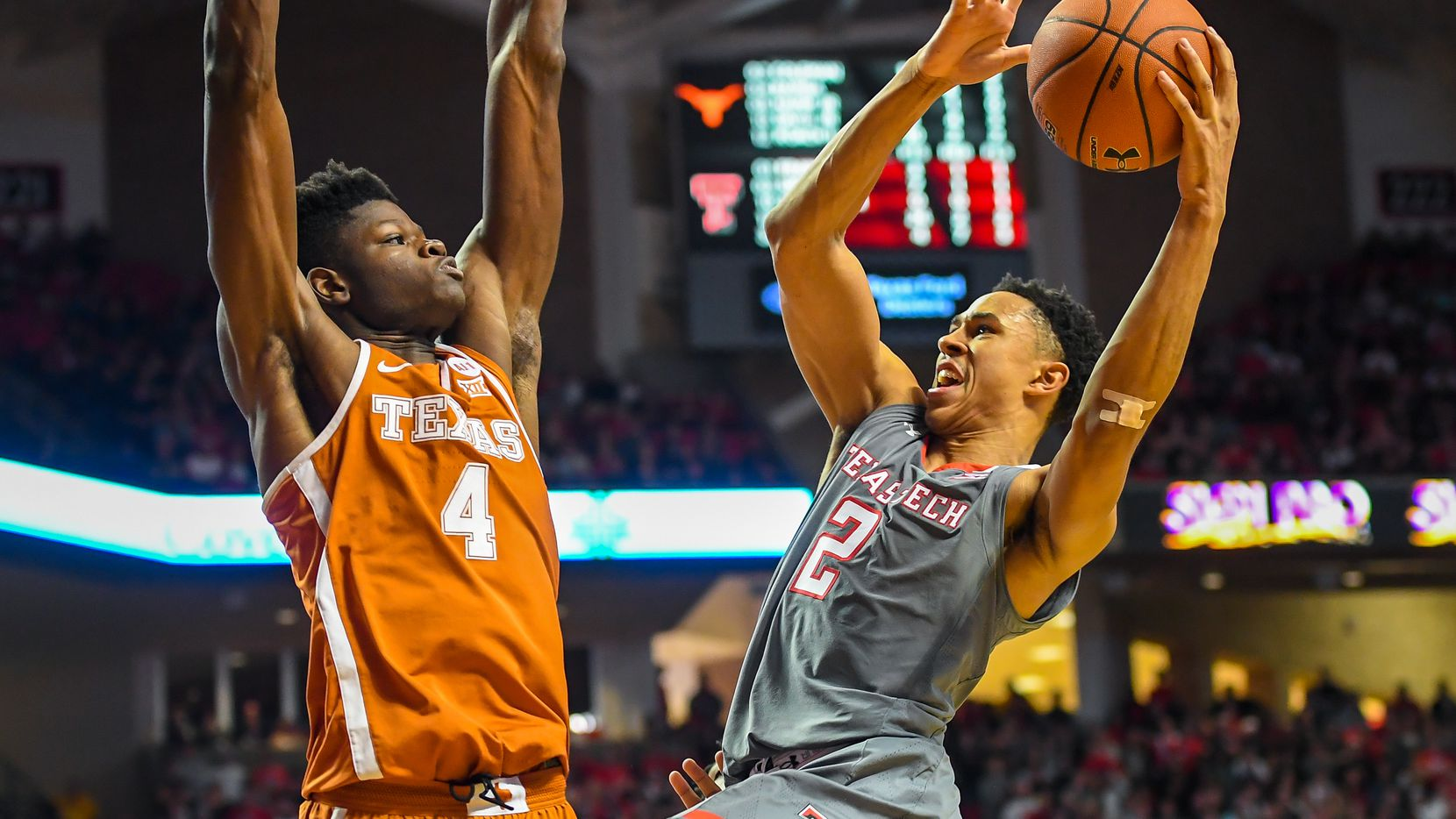 LUBBOCK, TX - JANUARY 31: Zhaire Smith #2 of the Texas Tech Red Raiders goes up for a shot against Nohamed Bamba #4 of the Texas Longhorns during the game on January 31, 2018 at United Supermarket Arena in Lubbock, Texas. Texas Tech defeated Texas 73-71 in overtime. (Photo by John Weast/Getty Images)