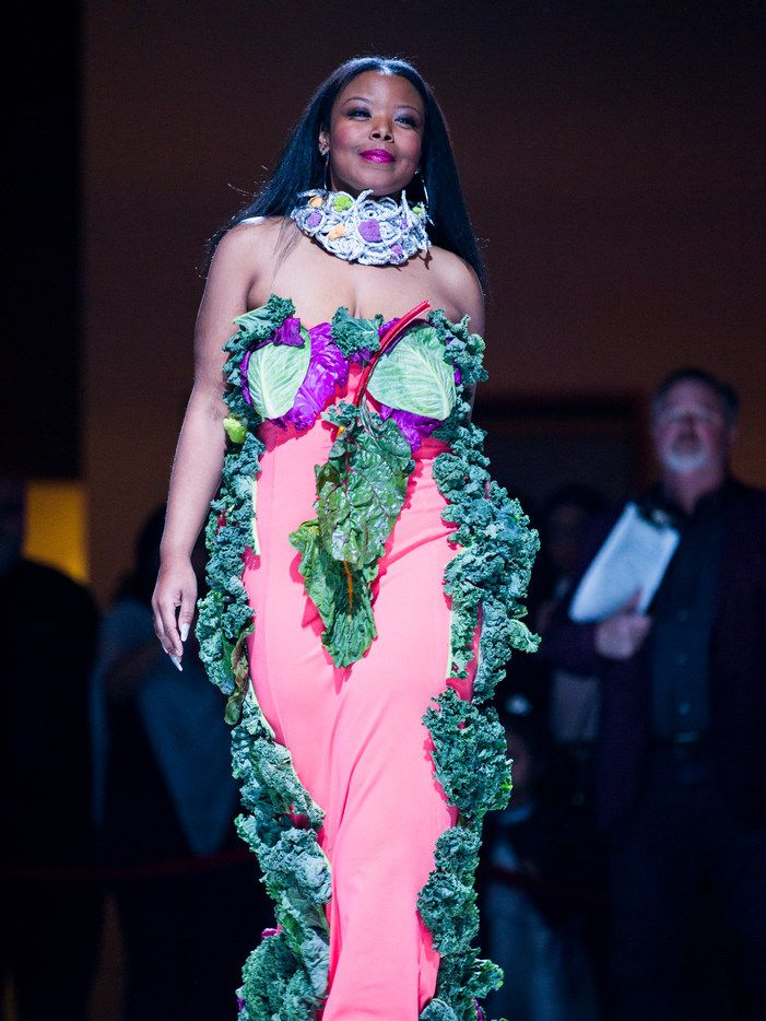 Model Dr. Candace Freeman walks down the runway wearing an original design by Josette Golatt during the Greater Dallas Restaurant Association's Food in Fashion event on Wednesday, Feb. 7, 2018, at Trinity Groves in Dallas.