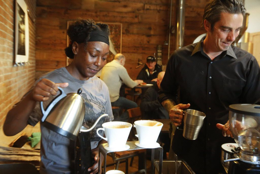 Alexandria Gilbert, left, and Michael Wyatt prepare coffee for customers at Full City Rooster Saturday morning.