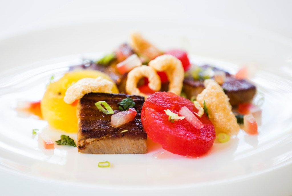 Texas red wattle pork belly with red and yellow watermelon and pickled watermelon rind.