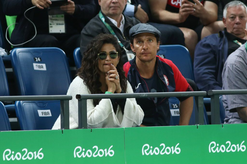 RIO DE JANEIRO, BRAZIL - AUGUST 10:  Actor Matthew McConaughey and wife Camila Alves react while watching the Men's Preliminary Round Group A game between Australia and the United States on Day 5 of the Rio 2016 Olympic Games at Carioca Arena 1 on August 10, 2016 in Rio de Janeiro, Brazil.