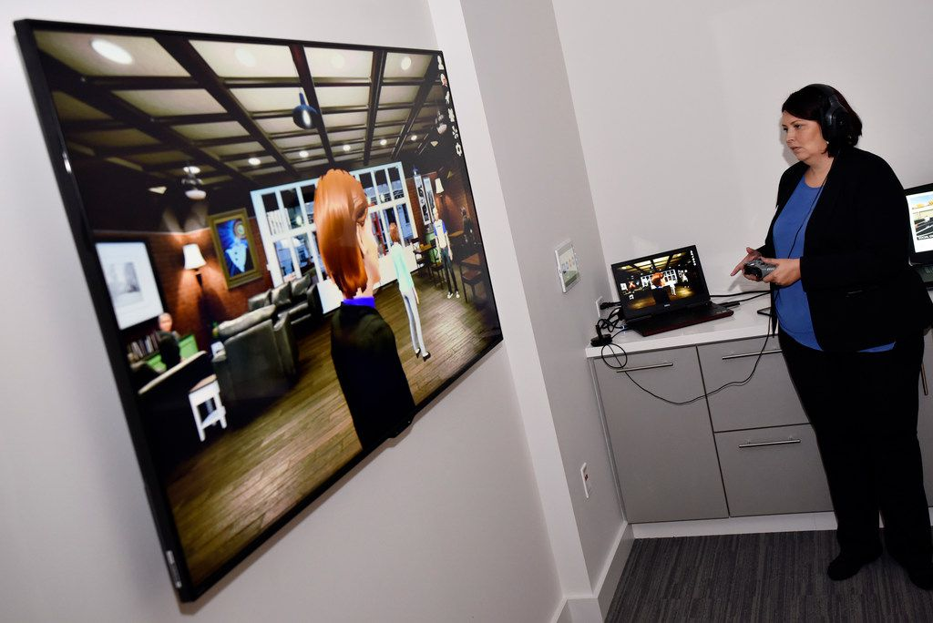Maria Johnson, the institute's senior clinician, demonstrates a virtual reality coffee shop where people can meet for job interviews or first date scenarios in a virtual world.