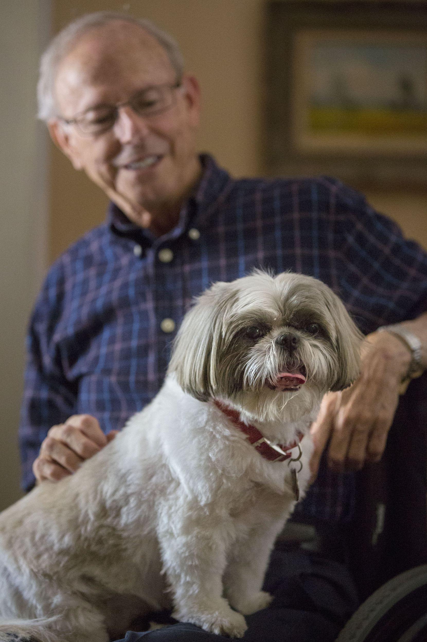 Don Rorschach and his dog, Orli, at Rorschach's home in Irving, Texas.