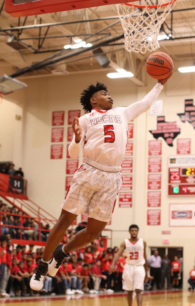Cedar Hill guard Jairus Adley (5) skies to pull in a rebound on the defensive boards during first half action against DeSoto. The two teams played their District 8-6A basketball game  at Cedar Hill High School on January 15, 2016. (Steve Hamm/Special Contributor)