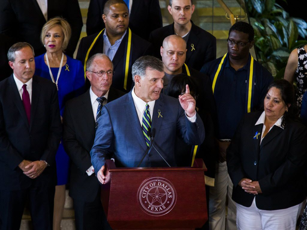 Dallas Mayor Mike Rawlings (center) speaks with Texas Governor Greg Abbott (not pictured) during a press conference on Friday, July 8, 2017 at Dallas City Hall in downtown Dallas, Texas. (Ashley Landis/The Dallas Morning News)