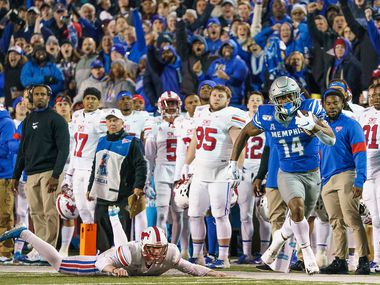 Memphis wide receiver Antonio Gibson (14) leaves SMU kicker Russell Roberts (97) behind as he returns the opening kickoff of the second half 97 yards for a touchdown during an NCAA football game at Liberty Bowl Memorial Stadium on Saturday, Nov. 2, 2019, in Memphis, Tenn. (Smiley N. Pool/The Dallas Morning News)