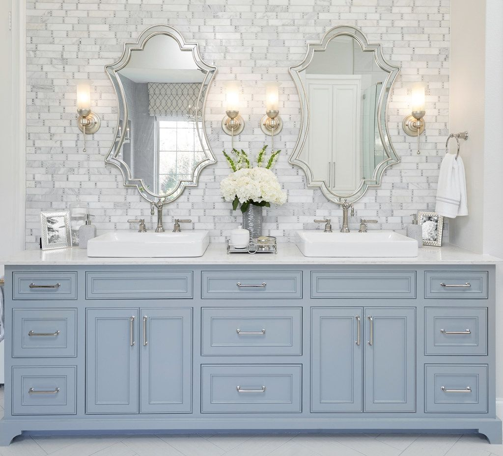 You can't go wrong with sconces above a vanity, says Emily Sheehan Hewett.