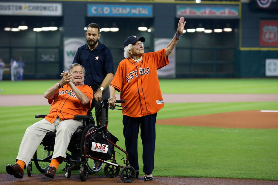 Former President George H.W. Bush along with wife Barbara prepares to throw out the ceremonial first pitch before Game 3 of baseball's American League Division Series between the Kansas City Royals and Houston Astros in 2015.