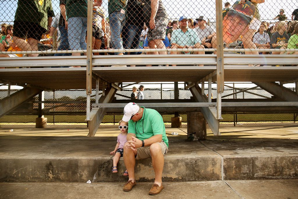 Ada Jackson, 2, sits with her grandfather Greg Cain, of Kingwood, Texas, before the second game of the best-of-three series in the Class 5A Region III playoff high school baseball game between Santa Fe and Kingwood Park at Jim Kethan Field at Deer Park High School in Deer Park, TX Saturday May 19, 2018. On Friday morning, 10 people were killed and 13 were injured after a shooting at Santa Fe High School. The game was postponed to Saturday after it was scheduled for Friday. Dimitrios Pagourtzis was booked into the Galveston County Jail on capital murder charges.