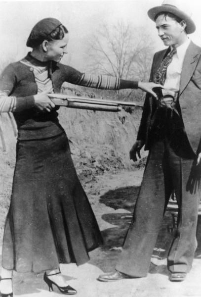 Bonnie Parker playfully pointed a rifle at Clyde Barrow in a photo taken during their deadly two-year crime spree in the early 1930s.