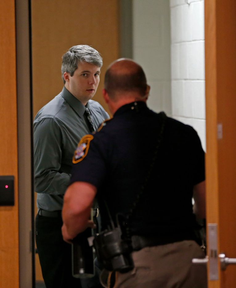 Defendant Jason Lowe (left) heads into a holding cell with a deputy during a court break on Tuesday in his murder trial at the Collin County Courthouse in McKinney, Texas, Tuesday, Sept. 19, 2017.