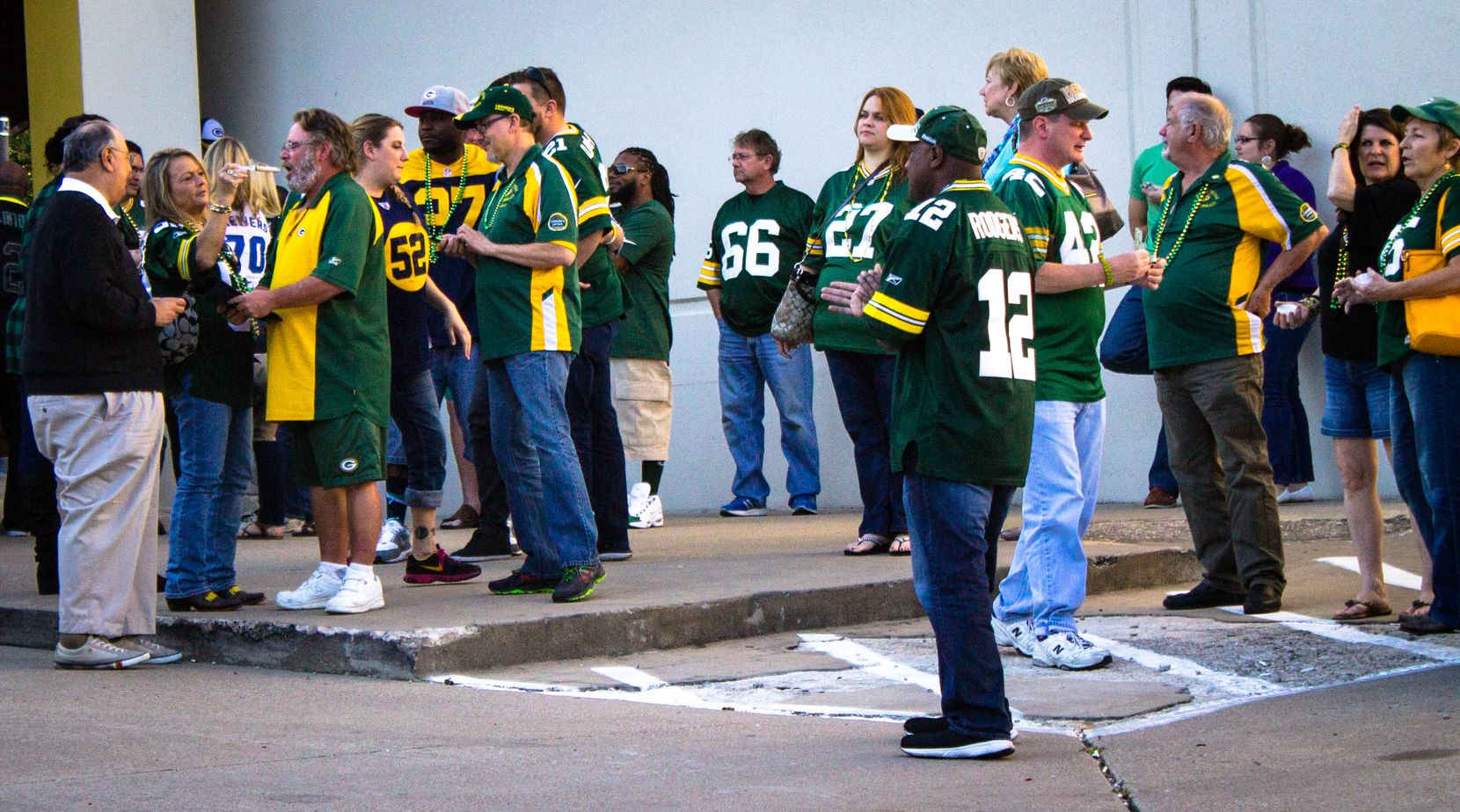 Green Bay Packers fans stretch their legs during halftime at Vernon's Gastropub in Addison.