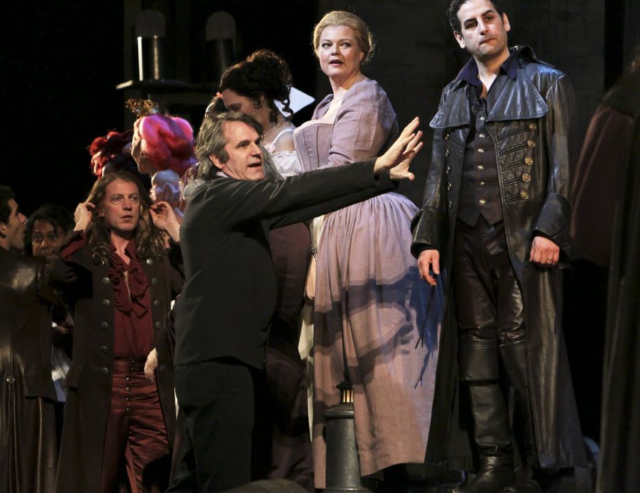 """Bartlett Sher, center, directs cast members during a rehearsal of """"Le Comte Ory,"""" at the Metropolitan Opera in New York, March 18, 2011."""