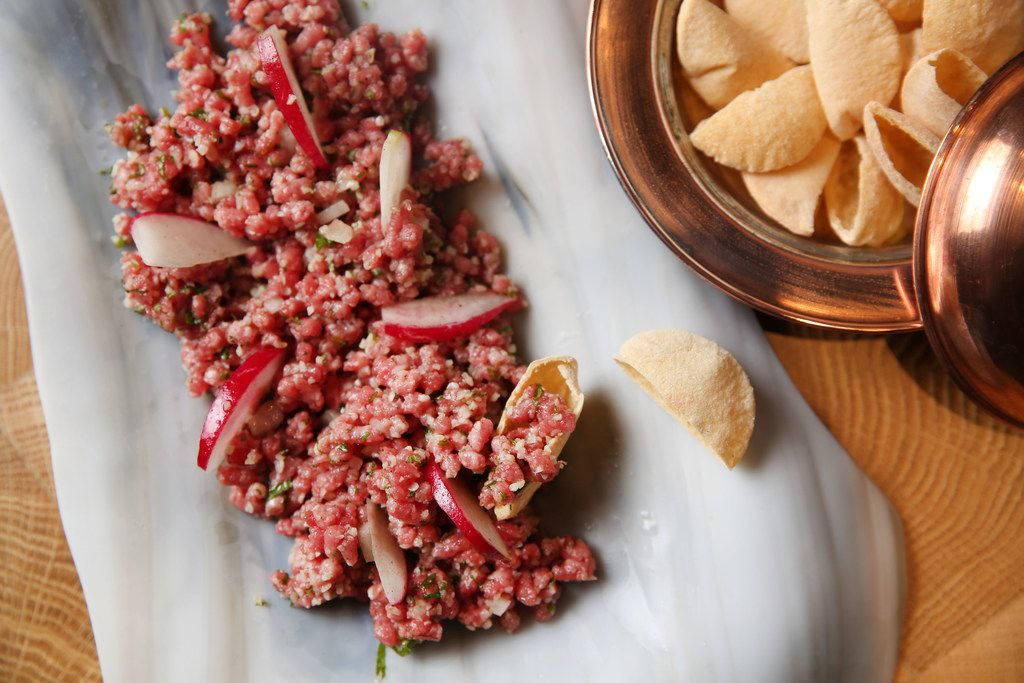 Kibbeh Nayeh with grass-fed Randall Linebacks ruby veal from Chapel Hill Farm in a Lebanese-style tartare ground to order, bulgur wheat, radish and pita chips photographed at Zaytinya in Frisco, Texas on Monday, Feb. 5, 2018. (Rose Baca/The Dallas Morning News)