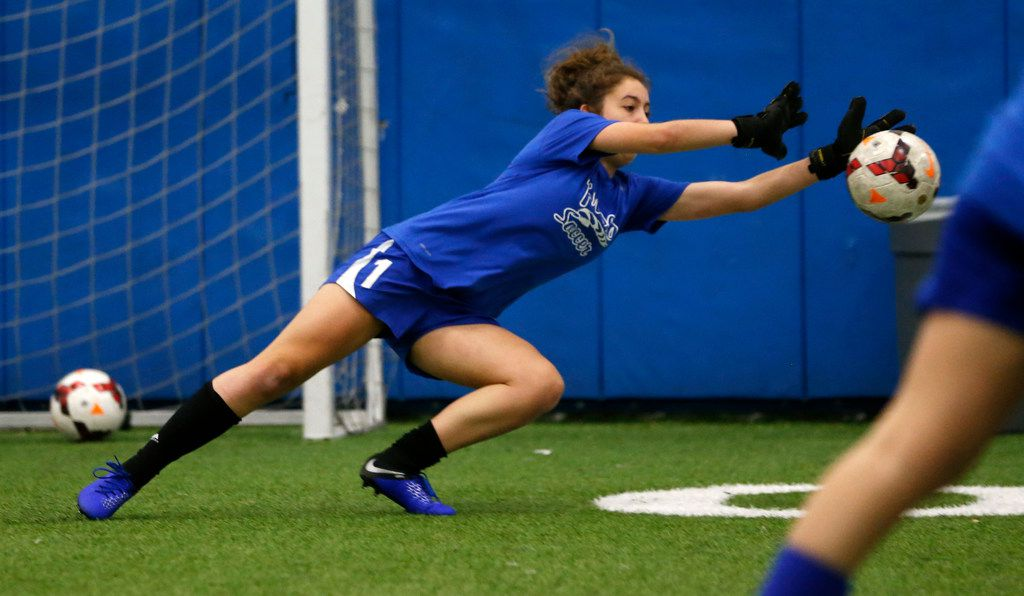 Lilly Heit blocks a shot during soccer practice at Frisco High School.